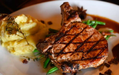 The main entree from Blind Box BBQ, a participator in Kansas City Restaurant Week, which consists of a wood-fired pork chop, seasonal vegetables, and mashed potatoes.