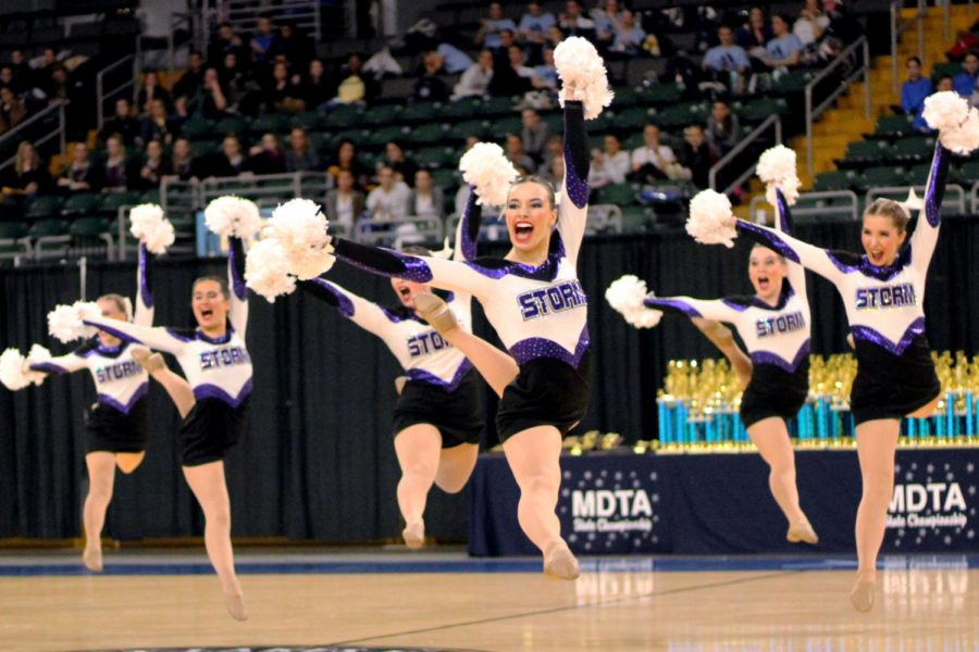 Co-captain senior Megan Broomfield leaps during Dance Team's pom performance at State Feb. 23. The team won first for their pom performance and first overall for the tenth consecutive year.