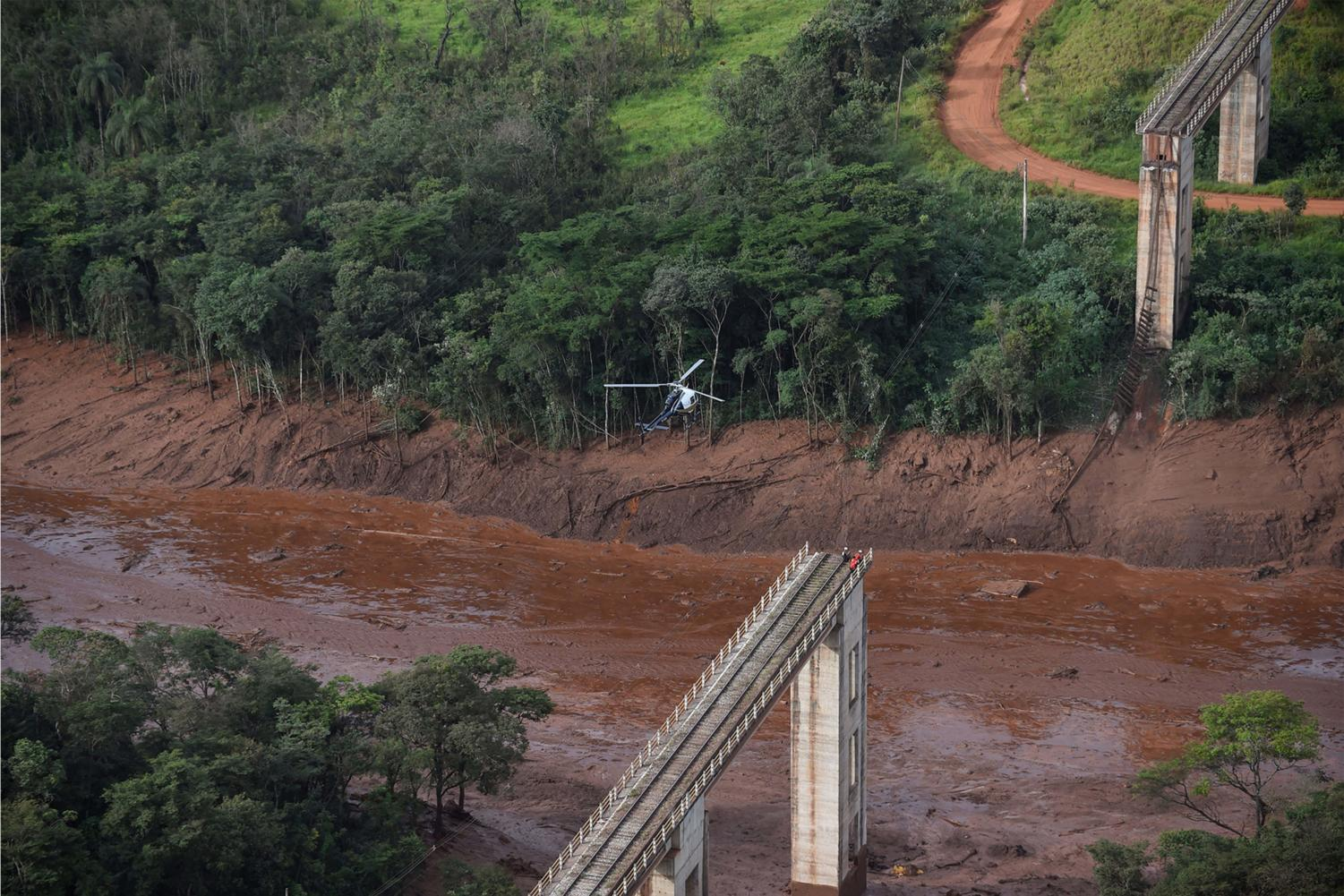 Aerial view taken after the collapse of a dam which belonged to Brazil's giant mining company Vale, near the town of Brumadinho in southeastern Brazil, on Friday, Jan. 25, 2019. The collapse unleashed a torrent of mud on a riverside town and surrounding farmland, destroying houses, leaving 200 people missing and raising fears of a number of deaths, according to officials. (Douglas Magno/AFP/Getty Images/TNS) **FOR USE WITH THIS STORY ONLY**
