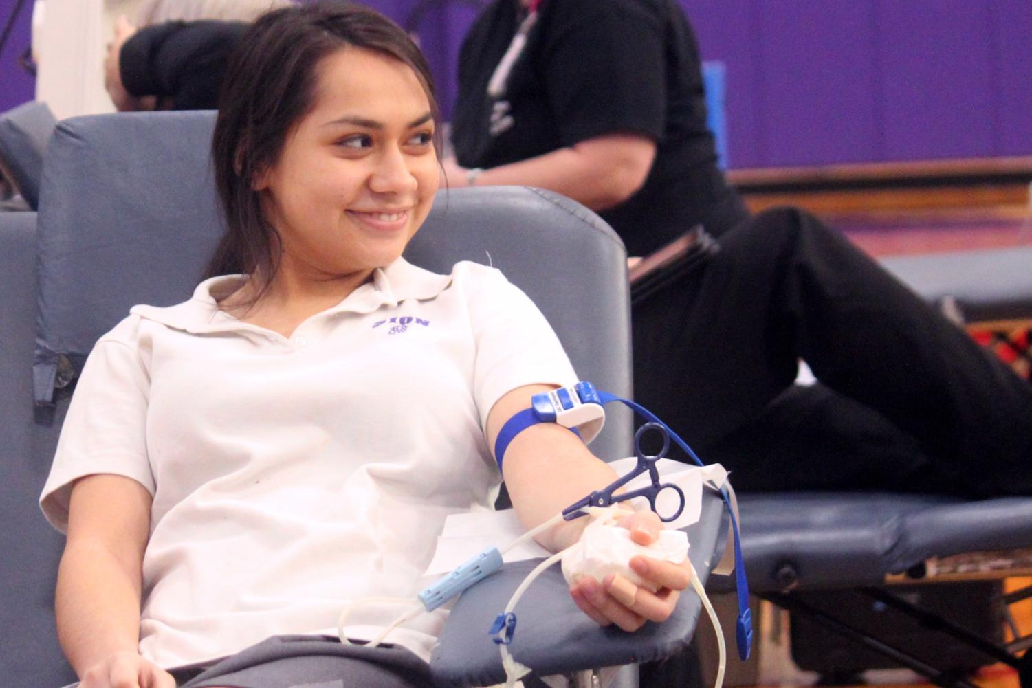 Junior Denise Carmona donates blood at the annual blood drive organized by the National Honors Society, Feb. 2, 2018.