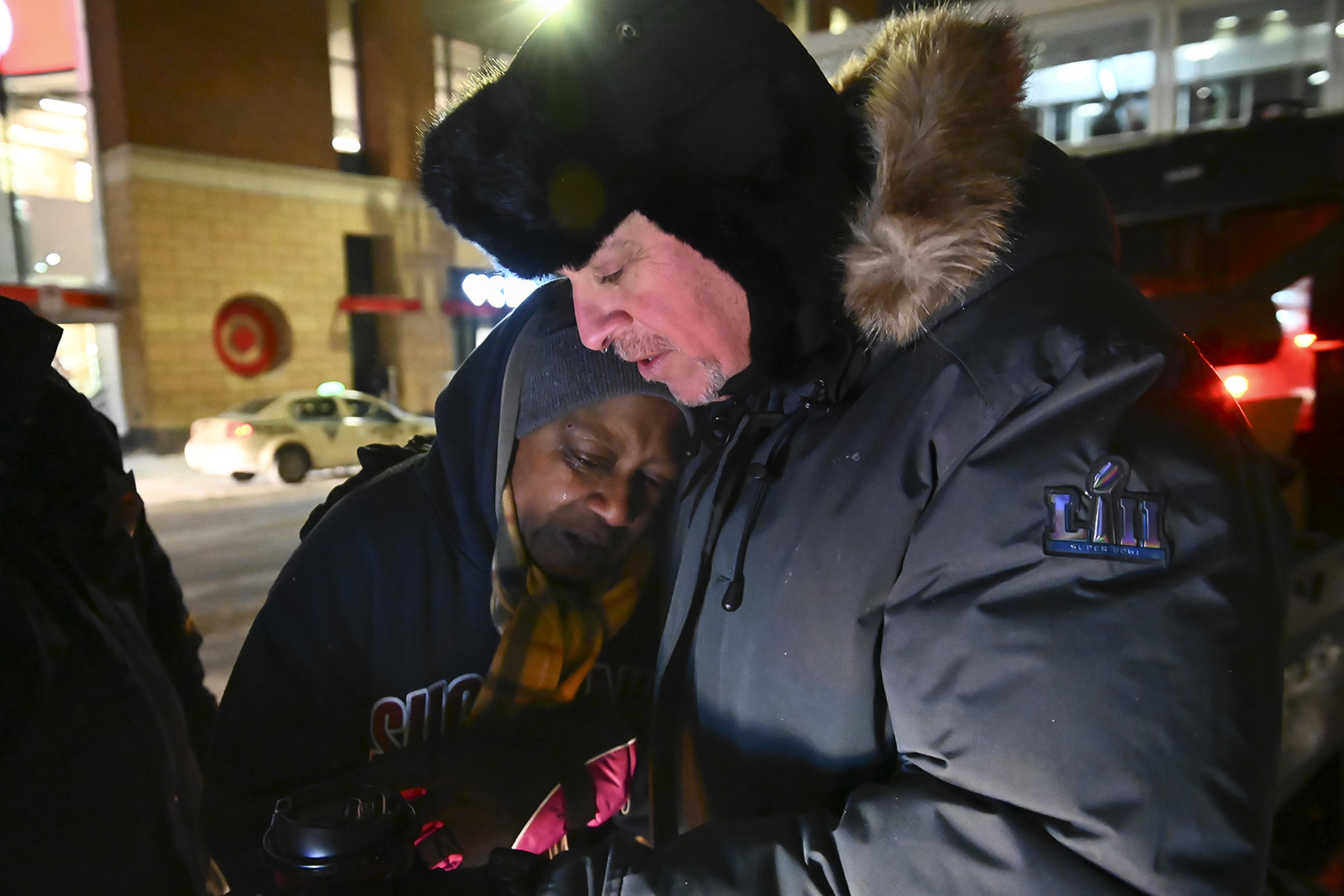 Pastor John Steger, with Grace In The City church, embraces Jearline Cyrus, a homeless woman, in downtown Minneapolis on Tuesday night, Jan. 29, 2019 while delivering cold-weather gear, hot chocolate and food with Minneapolis Police Sgt. Grant Snyder. (Aaron Lavinsky/Minneapolis Star Tribune/TNS)