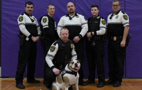 Cpl. Federico Amigoni, Ofc. Aaron Calovich, Chief Charles S. Bell; Sgt kevin B. McNiese, Ofc. Ashley Tedford, and Cpl. William Kelly, with the TAPSKC mascot K9 Rugar-the-Watchdog are the full-time officers that can be spotted on campus.