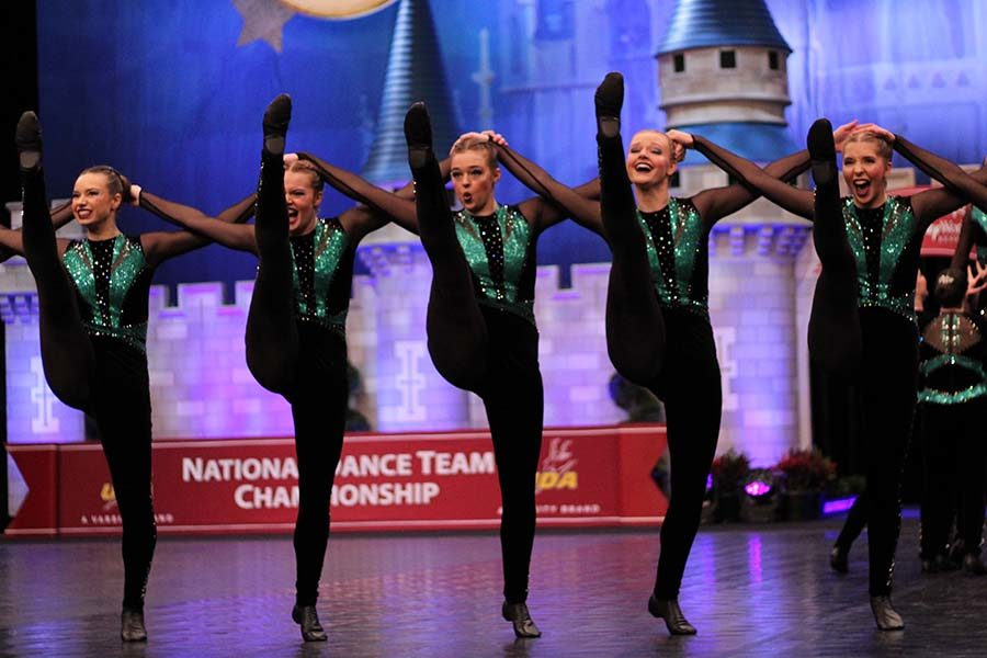 Seniors Megan Broomfield, Kristen Rogge, Chandler Rawson and Emily Kocca, with junior Libby Slaymaker preform the team's kick routine at Nationals Feb. 2.