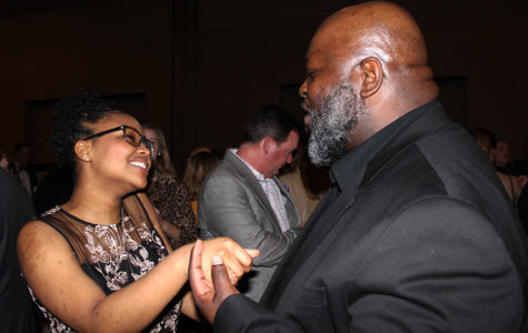 Freshman Kenzie Warren and her father David Warren dance together at the father-daughter dance Feb. 10.