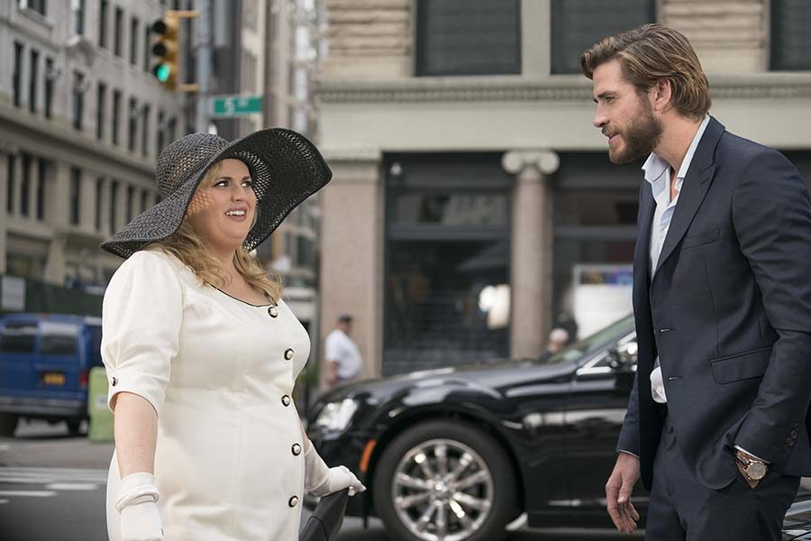 Natalie played by Rebel Wilson and Blake played by Liam Hemsworth, have an awkward conversation while standing in the middle of the street in New York city.