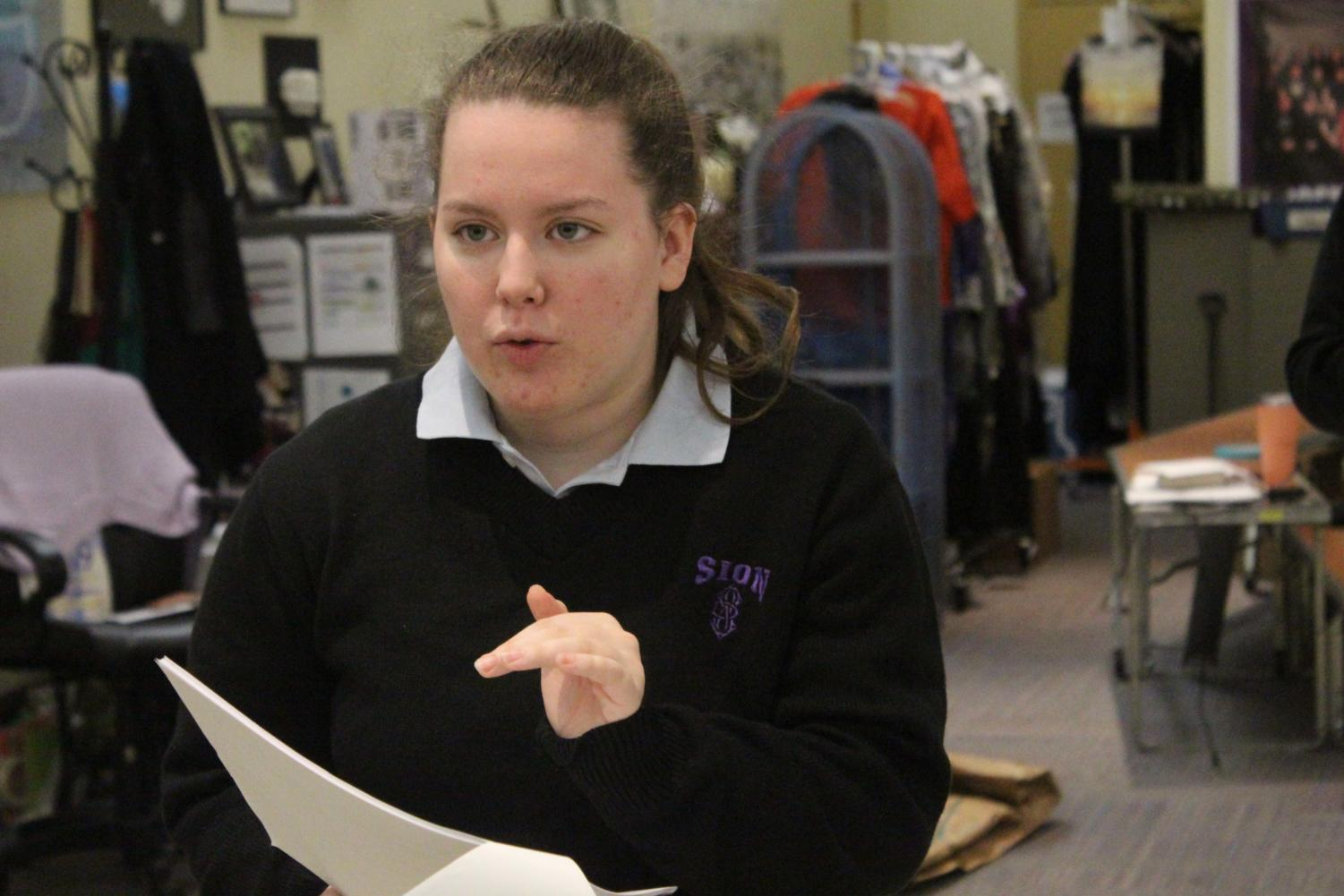 Senior Tess Prusa rehearses one of her monologues from the play about a  conversation between mother and  daughter.