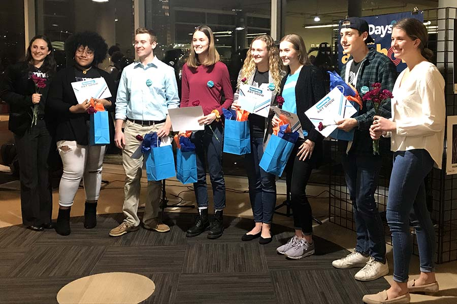 Sophomore Olivia Overlease attended the art showcase for the winning students of the Seven Days Art Contest at the Plaza Library Feb. 26. Overlease is the fourth person from the right.