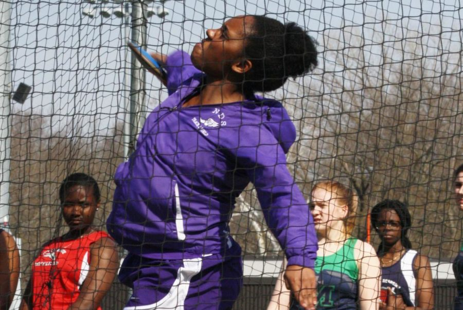 Senior+Kendall+Rogers+throws+shot+put+at+the+Bishop+Miege+Invitational+April+5.+%28Photo+by+Allie+Dierks%29