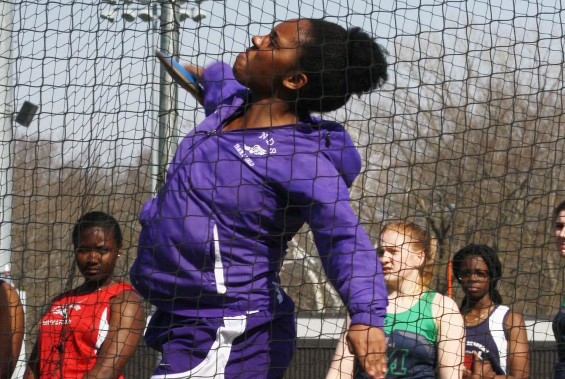 Senior Kendall Rogers throws shot put at the Bishop Miege Invitational April 5. (Photo by Allie Dierks)