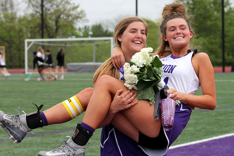 Sophomore Avery Myricks hold her sister senior Keali Myrick after the Varsity lacrosse game and senior night April 29. The team beat Lee's Summit West 12-8.