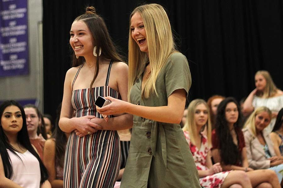 Carrying the class ring for a junior, seniors Scout Kneely and Sophie Hewitt walk up to present Lauren Mead her ring April 11.