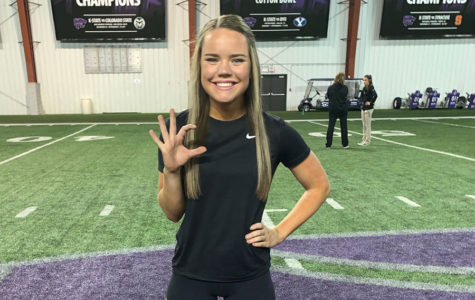Standing in the middle of the Power Cat, senior Liz Oltjen beams with excitment after making the Kansas State University cheer team April 28.