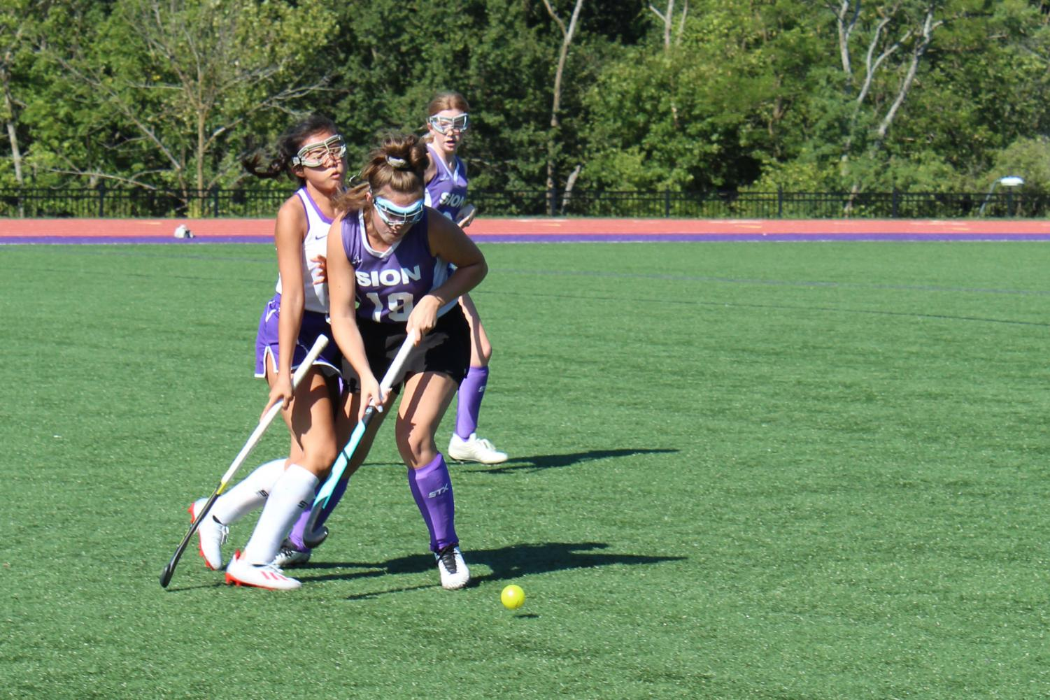 Junior+Lia+Concannon+and+sophomore+Isabella+Wilson+collide+in+a+fierce+1-on-1+for+the+ball.