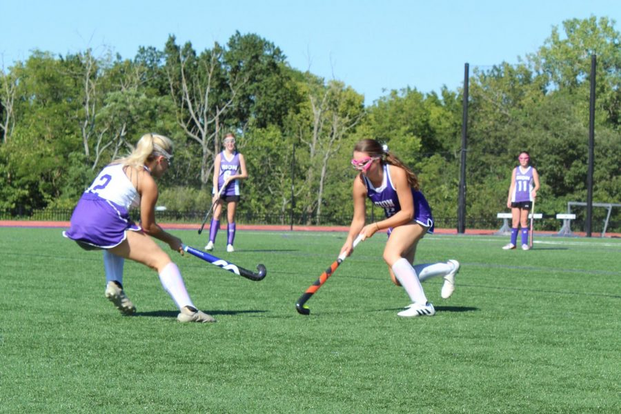 Juniors Hannah McGraw and Emma Grojean go head to head for possession of the ball.