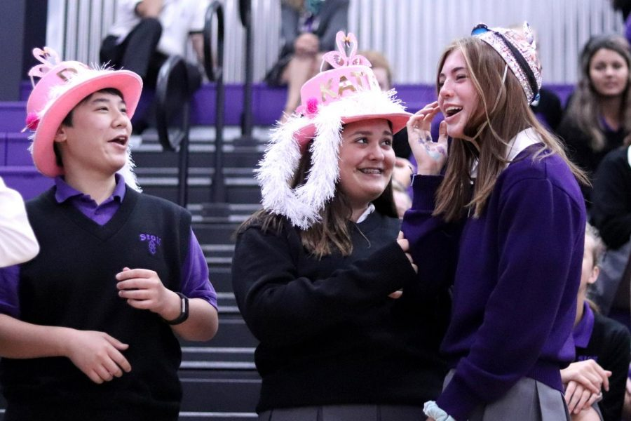 Freshmen Dori Sandritter, Katherine Porch and Grace Gaither react to their new pink accessories.