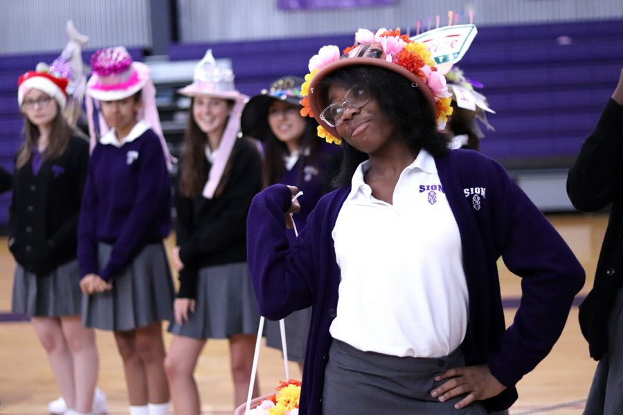 Freshman Kaila Traylor flaunts her flower themed beanie for the audience.