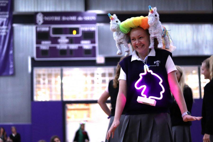 Freshman Makayla Herbert, member of Maison Long, struts with a unicorn themed beanie Aug. 22.