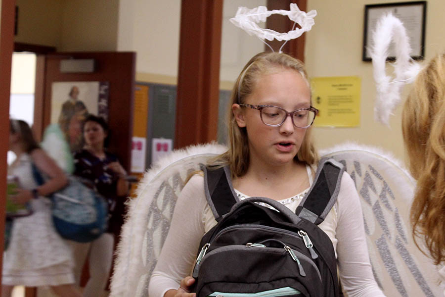 Senior+Brie+Bowes+enters+her+second-hour+class+with+white%2C+feathered+angel+wings+and+a+halo+Sept.+11+for+the+third+day+of+Spirit+Week.+