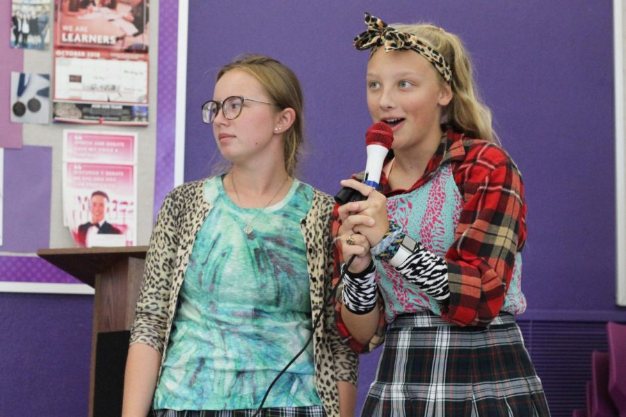 Seniors Grace Parrot and Brie Bowes, dressed in plaid and cheetah print, give a Scream Team announcement during lunch Sept 9. The theme for day one of Spirit Week was Pattern Day.