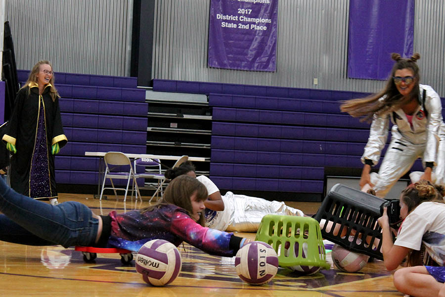 Playing+life-size+Hungry+Hungry+Hippos%2C+freshman+Caroline+Dold+dives+for+a+volleyball+during+the+pep+assembly%27s+class+competition+Sept.+10.+%0A