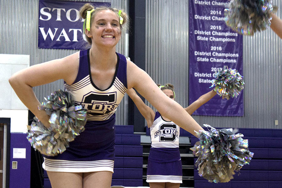 During+the+first+pep+assembly+of+the+year%2C+Junior+Emily+Bukaty+shows+the+school+the+team%E2%80%99s+new+cheer+routine+Sept.+10.+