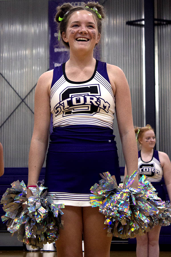 Seconds+before+cheer%E2%80%99s+first+performance+of+the+year%2C+senior+Brook+Mckee+friends+cheer+her+on+from+the+audience+at+the+pep+assembly+Sep.+10.+%0A