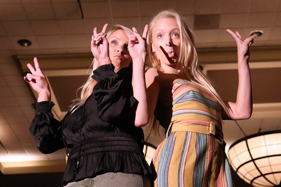 Senior+Olivia+Townsend+and+her+mom+Kris+Townsend+strike+a+pose+for+the+audience+during+the+fashion+show+Sept.+15.