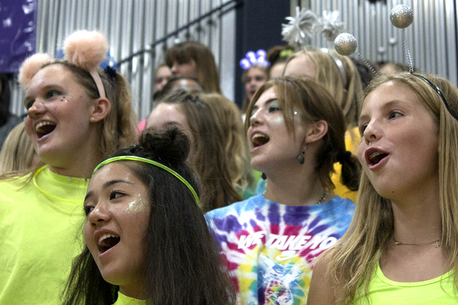 Decked+out+in+their+Alien-51+gear+for+their+fist+Sion+Spirit+Week%2C+freshmen+Claire+Shankland%2C++Caroline+Dold%2C+Aleigh+Mckelvey+and+Mallory+Vance+yell+out+a+cheer+at+the+pep+assembly+Sep.+10.+