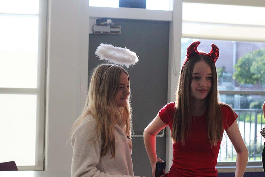 Freshmen+Gabel+Whittaker+and+Farrah+Allen+talk+to+friends+during+lunch+while+dressed+in+theme+for+Devils+and+Angels+Spirit+Week+day+Sept.+11.