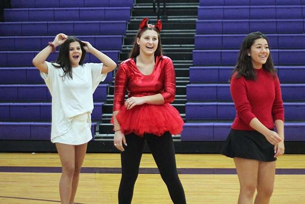 Freshmen+Aleigh+Mckelvey+and+Amelia+Maguire+wait+to+enter+a+volleyball+game+along+with+junior+Mia+Legatto+Sept+11.+Students+dressed+in+devil+and+angel-themed+costumes+for+Spirit+Week+Sept.+11.