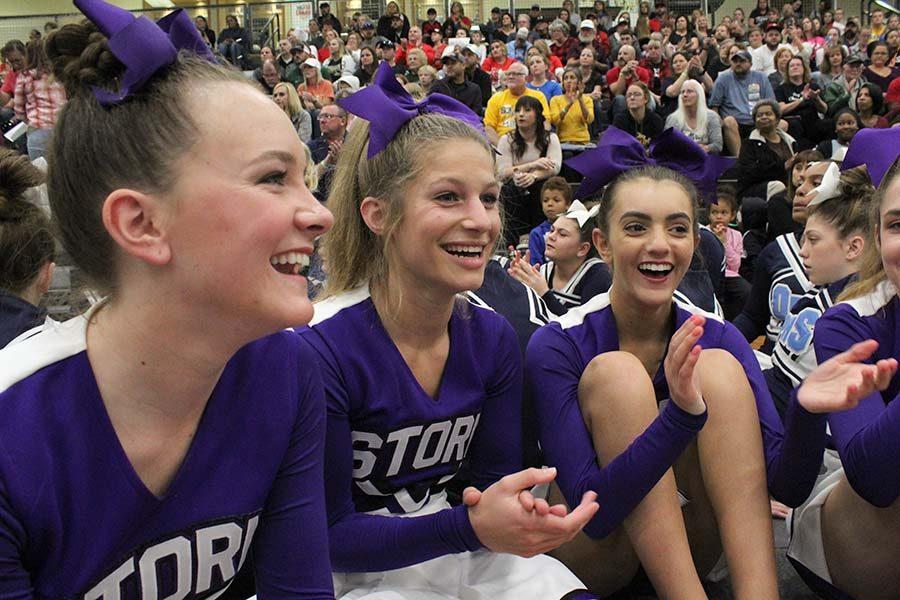 Senior Captains Brooke McKee, Caroline Knopke and Meg Wilkerson cheer on other teams' results at Regionals Oct. 20.