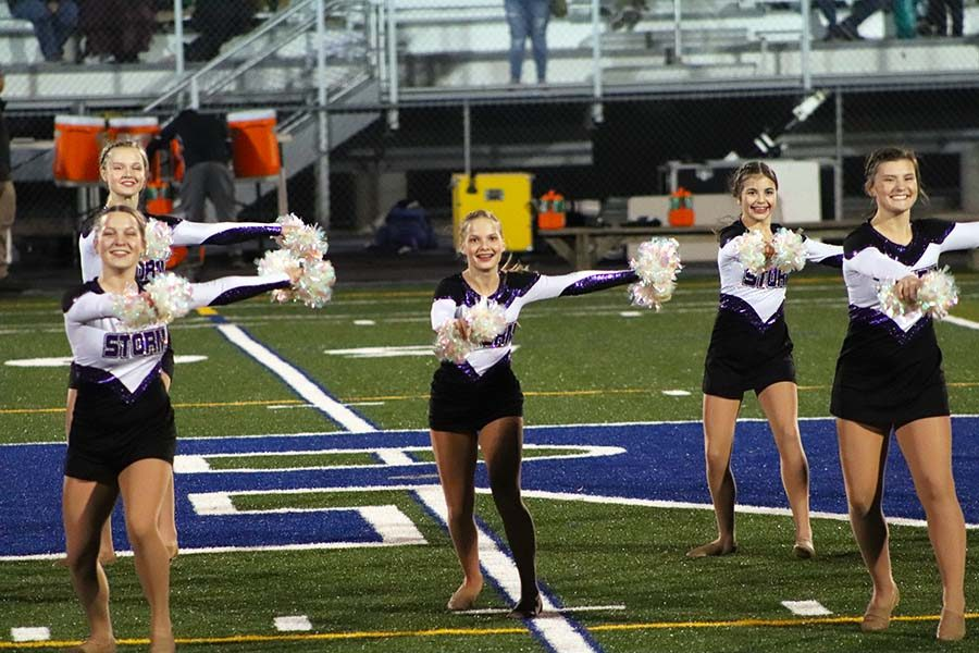 Dancers ready themselves before a leap at their performance during the Rockhurst High School football game Oct. 18.