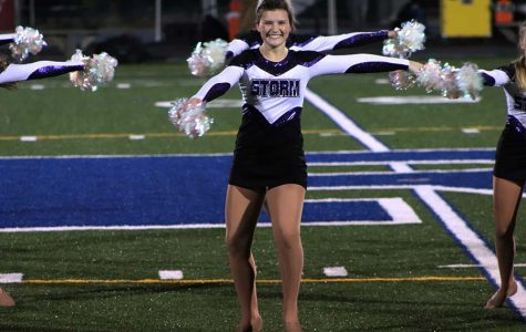 Senior Ava Grace Vermillion preps for a turn during the dance team performance at Rockhurst High School Oct. 18. This was Vermillion's last performance at Rockhurst.