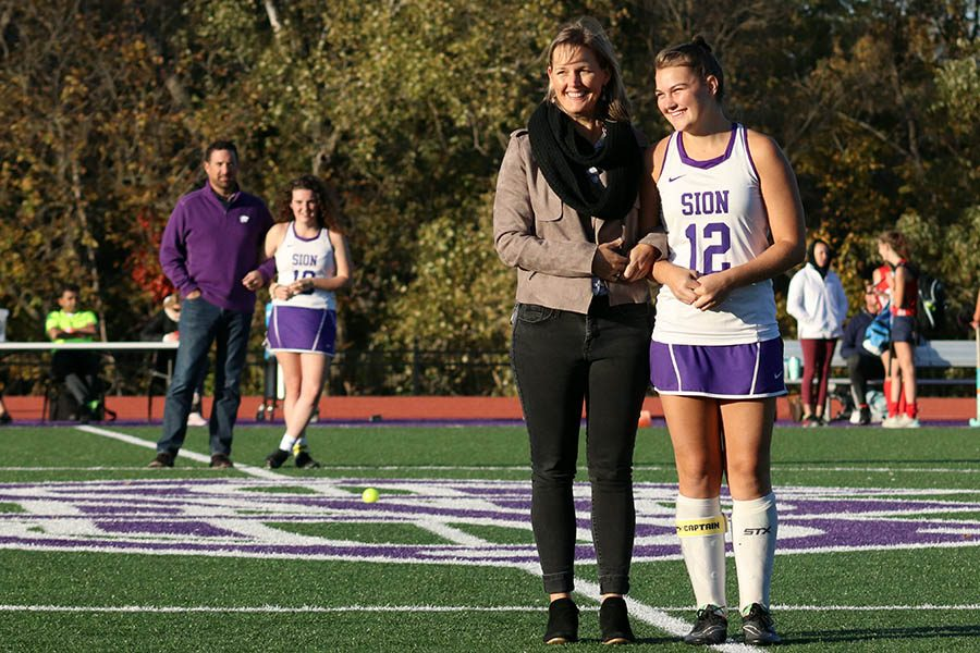 Senior Sam Shively is honored alongside her mother for field hockey's Senior Night Oct. 22. The field hockey team lost 3-1 to Pembroke Hill.