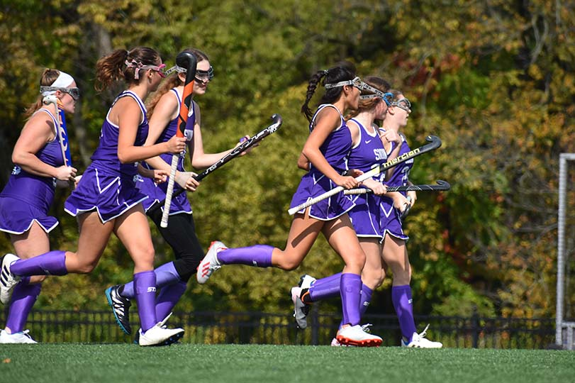Players+run+to+forward+senior+Lia+Concannon+after+her+goal+during+the+varsity+game+on+Oct.+19%2C+2019.+Varsity+won+1-0.