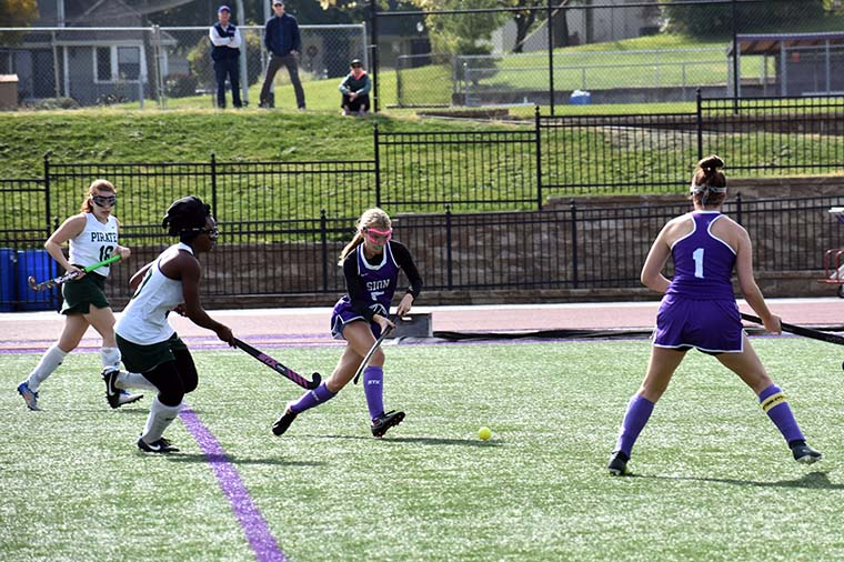 Sophomore forward Marie Messerli passes the ball upfield during the varsity game at Sion Oct. 19. Varsity won 1-0.