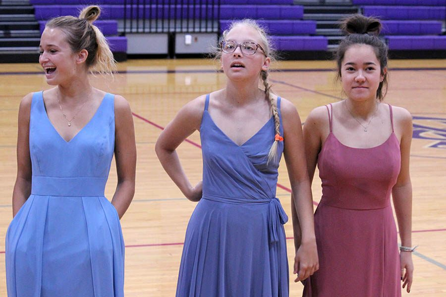 Seniors Nina Trouve, Brie Bowes and Paula Sweeny showed three of the five dress options to the senior class Oct. 16 during the class meeting. Graduation dresses are ordered from Bella Bridesmaids.