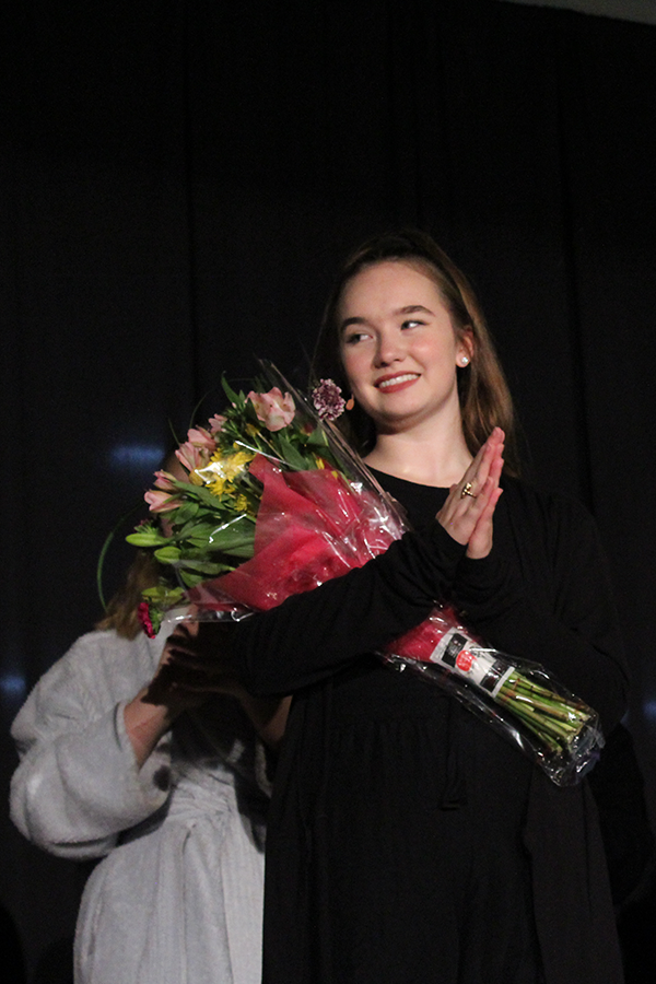 Cast and crew gifted co-director senior Peyton Wade with a flower bouquet at the conclusion of Night of One Acts Oct. 9.