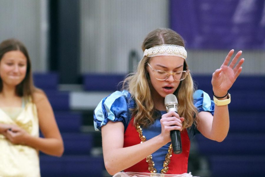 Sophomore Tess Tappan performs a rendition of 'The Star Spangled Banner' during her class's beauty pageant skit. Each grade put on a skit to raise excitement about the upcoming food drive Oct. 31.