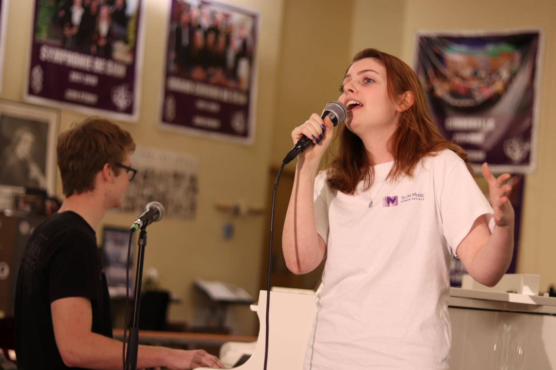 Sophomore Olivia Mancina and Rockhurst sophomore Ryan Campbell perform