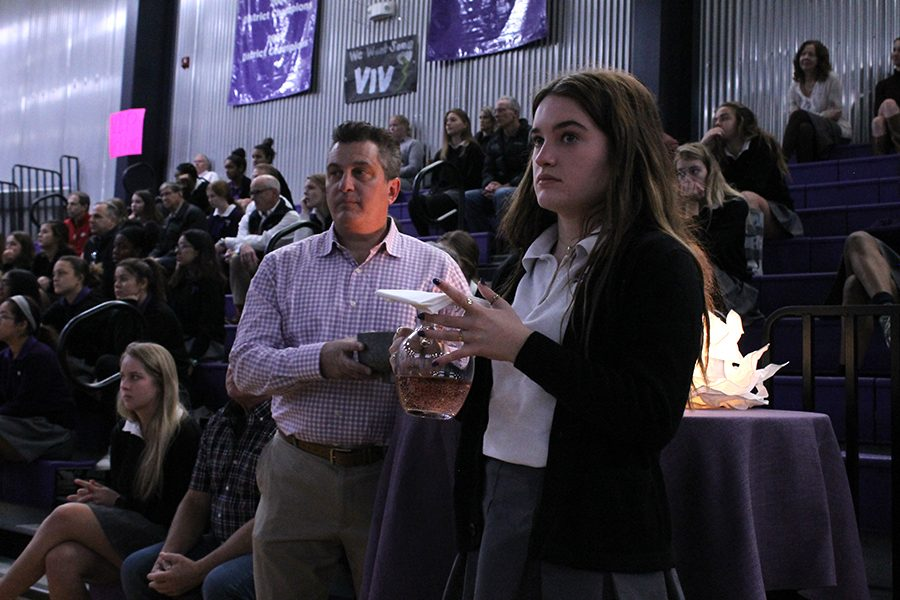 Sophomore Sophia Totta and her father Frank Totta bring up the gifts at the Father-Daughter Mass Nov. 1.