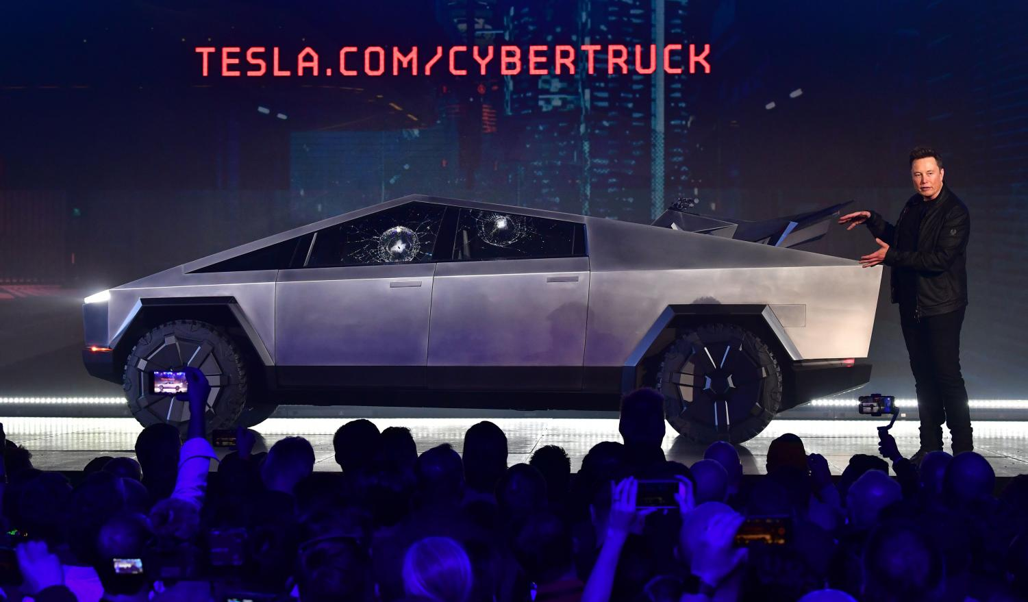 Tesla co-founder and CEO Elon Musk gestures while wrapping up his presentation of the newly unveiled all-electric battery-powered Tesla Cybertruck at Tesla Design Center on Nov. 21, 2019 in Hawthorne, Calif.