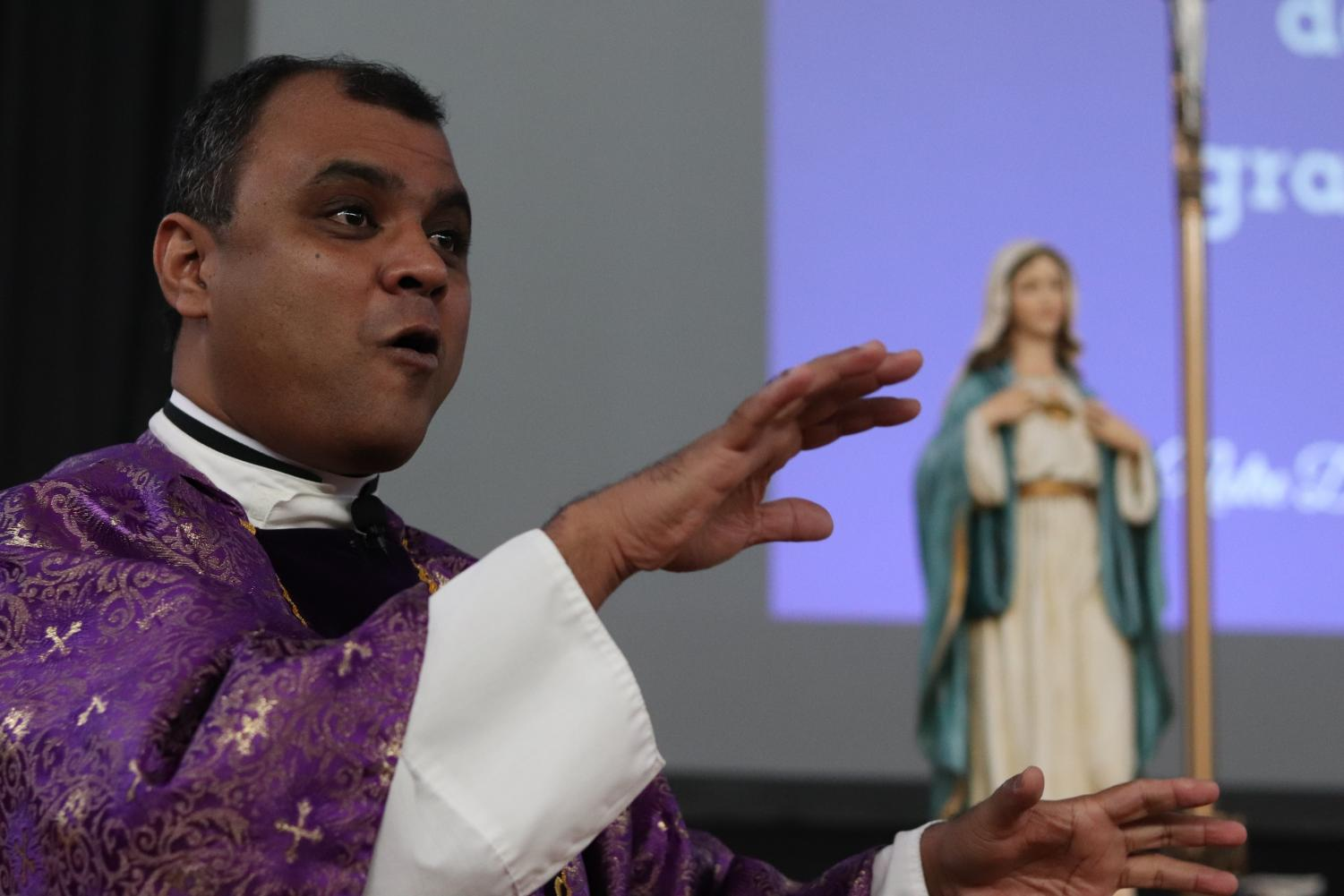 Father Sunoj Thomas precided over the annual Mother-Daughter-Grandmother Mass Nov. 5 in the gym.