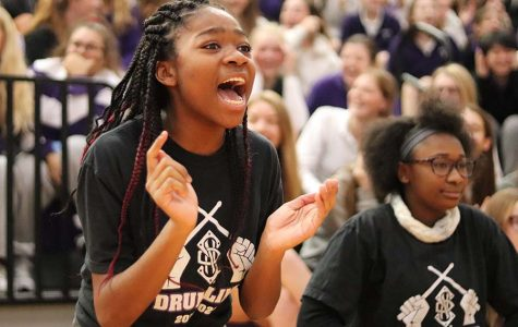 Freshman Makaila Traylor  screams for her classmate in a game of blindfold musical chairs during the pep assembly Friday, Nov. 6.