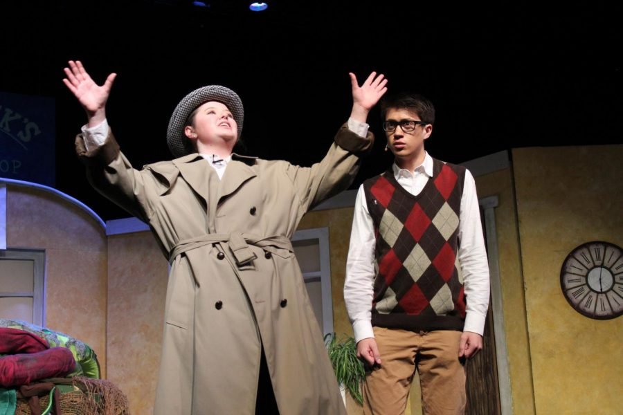 Junior Mattie Mills, in one of her many quick change roles, promises to promote Rockhurst High School junior Jack Winters's character, Seymour Krelborn, to stardom during the musical Jan. 17.