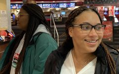 Seniors Maya Scott and Tehya Frederick wait in line at ticketing for the 7:00 p.m. showing of
