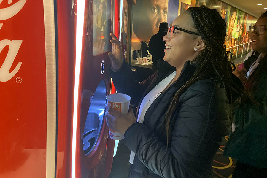 Senior Tehya Frederick purchased at drink at the concessions at AMC Ward Parkway 14 prior to the free screening of