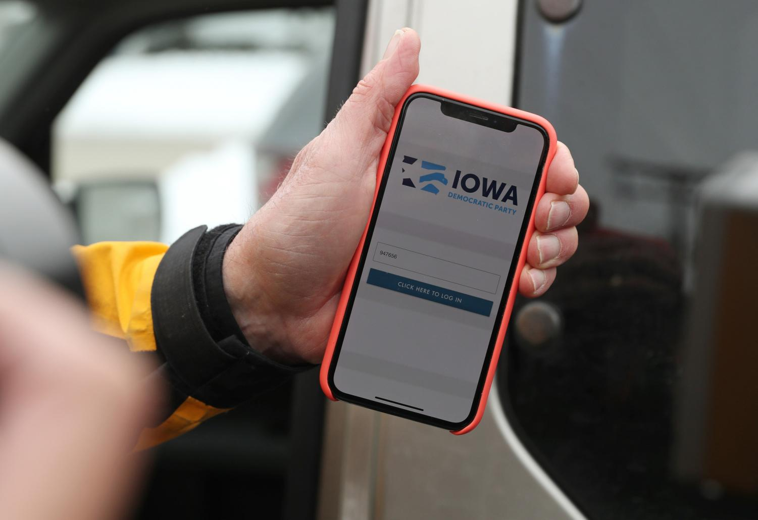 Precinct chair Carl Voss, of Des Moines, shows the phone app he used for the Iowa Caucus to news media at the Iowa Democratic Party headquarters, Feb. 4, 2020, in Des Moines.