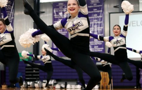Junior Kaitlyn Quinn leaps to the ground during dance team's performance at the pep rally Feb. 27.