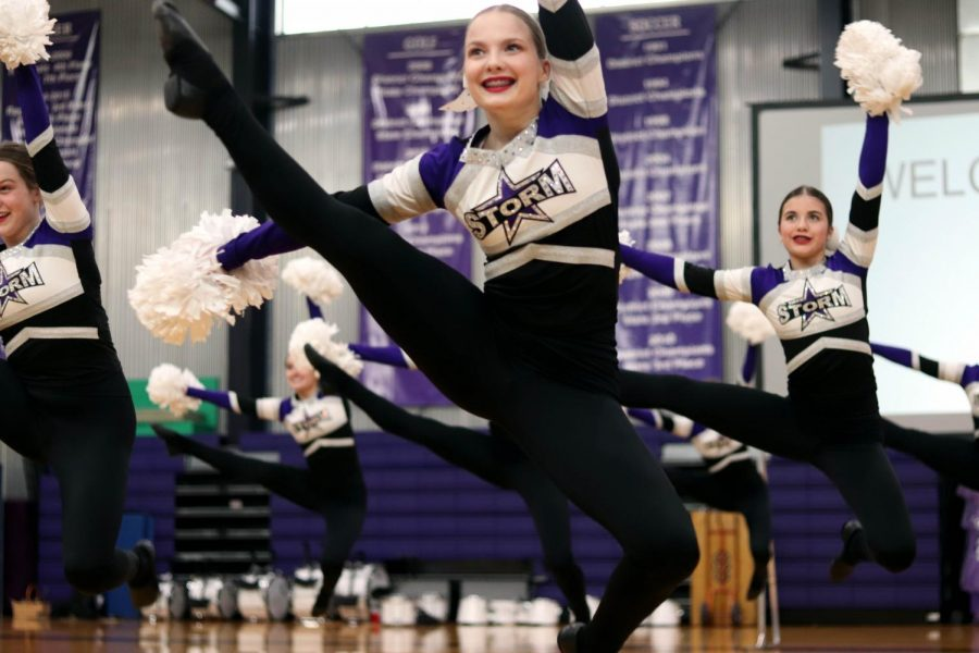 Junior+Kaitlyn+Quinn+leaps+to+the+ground+during+dance+team%27s+performance+at+the+pep+rally+Feb.+27.